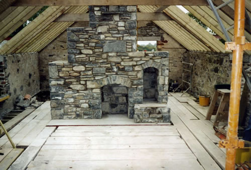 Stoves stone stoves for Large stone fireplace